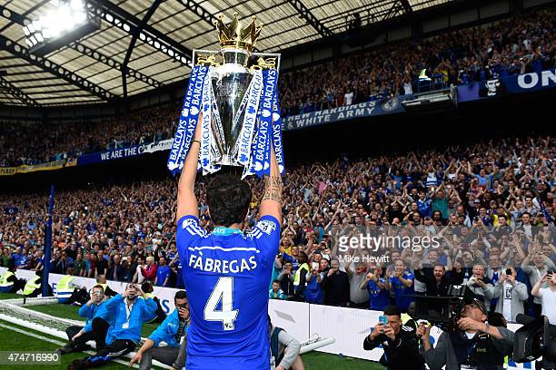 Cesc Fabregas of Chelsea celebrates with the trophy after the Barclays Premier League match between Chelsea and Sunderland at Stamford Bridge on May...