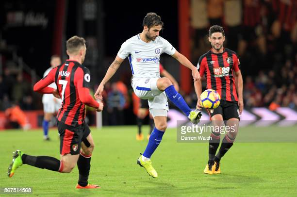 Cesc Fabregas of Chelsea controls the ball while under pressure from Andrew Surman of AFC Bournemouth during the Premier League match between AFC...