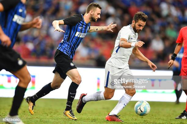 Cesc Fabregas of Chelsea FC and Marcelo Brozovic of FC Interernazionale competes for the ball during the International Champions Cup match between FC...