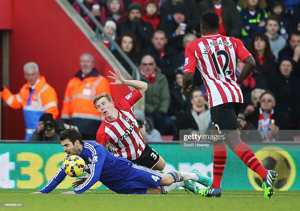 Cesc Fabregas of Chelsea goes down in the penalty area after a challenge by Matt Targett of Southampton and is booked for diving during the Barclays...