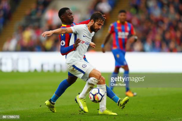 Cesc Fabregas of Chelsea holds off Jeffrey Schlupp of Crystal Palace during the Premier League match between Crystal Palace and Chelsea at Selhurst...