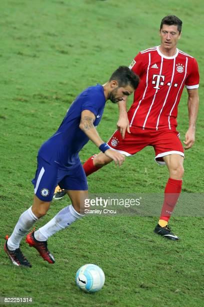 Cesc Fabregas of Chelsea holds off Robert Lewandowski of Bayern Munich during the International Champions Cup match between Chelsea FC and FC Bayern...