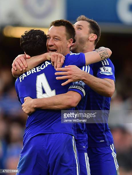 Cesc Fabregas of Chelsea hugs John Terry and Branislav Ivanovic of Chelsea after the Barclays Premier League match between Chelsea and Manchester...