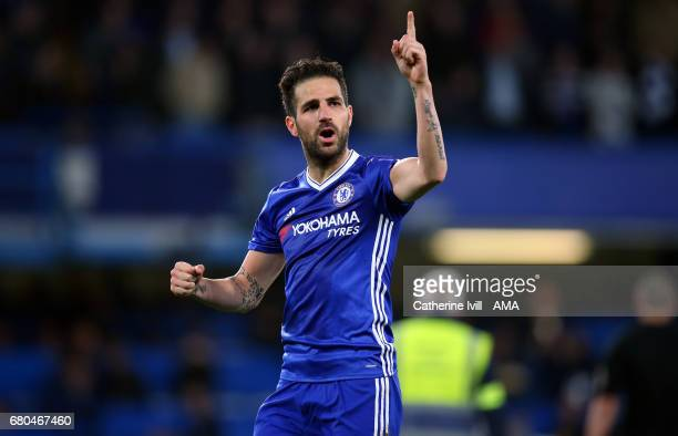 Cesc Fabregas of Chelsea indicates to the fans they need to win one more game after the Premier League match between Chelsea and Middlesbrough at...