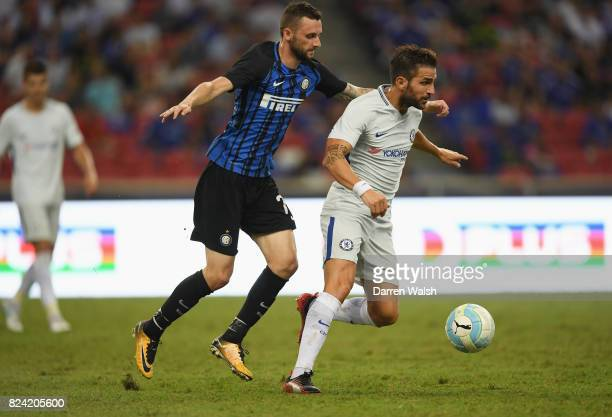 Cesc Fabregas of Chelsea is challenged by Marcelo Brozovic of Internazionale during the International Champions Cup match between FC Internazionale...