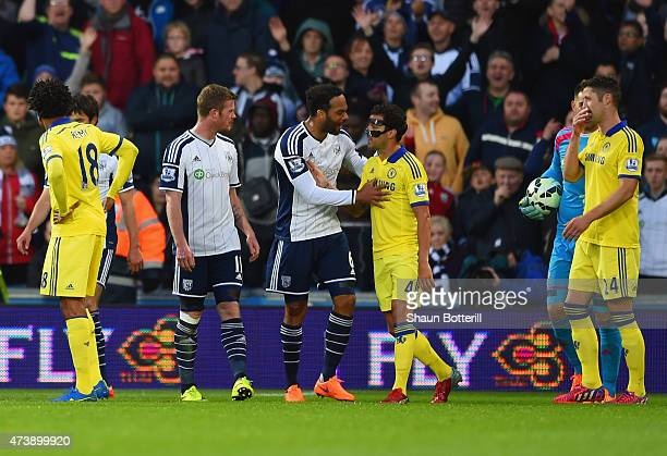 Cesc Fabregas of Chelsea is spoken to by Joleon Lescott of West Bromwich Albion as he is sent off during the Barclays Premier League match between...