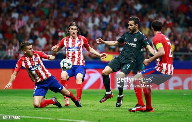 Cesc Fabregas of Chelsea is surrounded Atletico Madrid defenders during the UEFA Champions League group C match between Atletico Madrid and Chelsea...