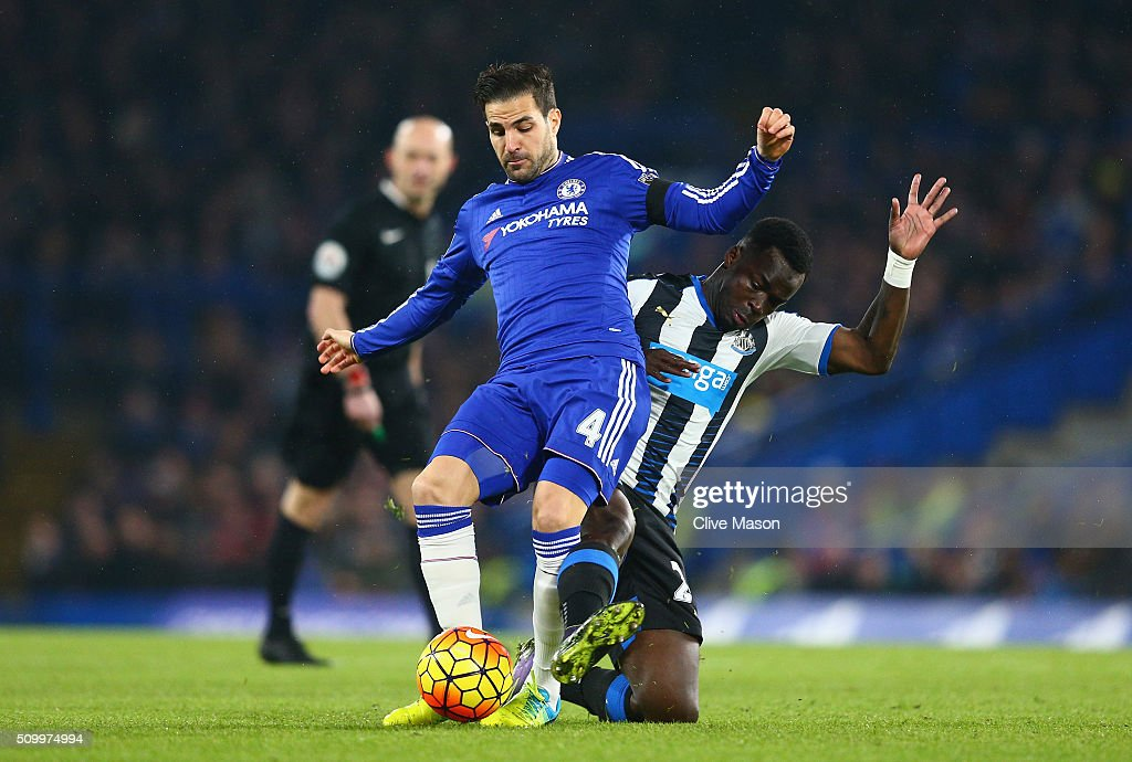 Sesc Fabregas of Chelsea is tacked by Cheik Ismael Tiote of Newcastle United during the Barclays Premier League match between Chelsea and Newcastle United at Stamford Bridge on February 13, 2016 in London, England.