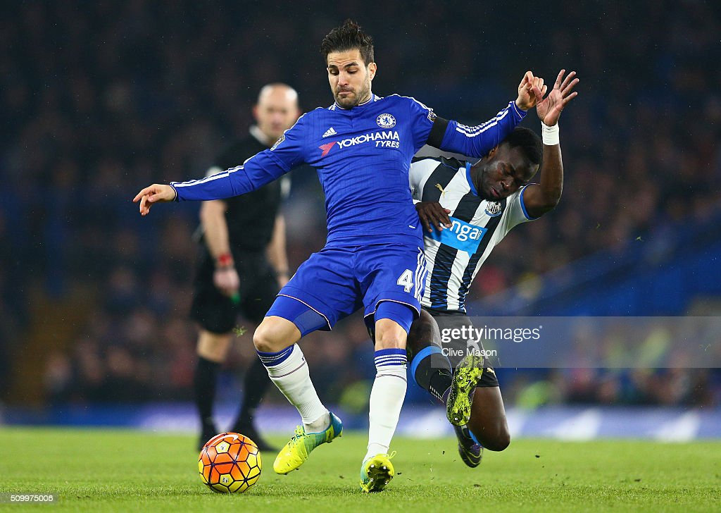 Cesc Fabregas of Chelsea is tacked by Cheik Ismael Tiote of Newcastle United during the Barclays Premier League match between Chelsea and Newcastle United at Stamford Bridge on February 13, 2016 in London, England.