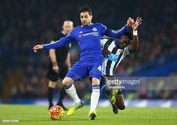 Cesc Fabregas of Chelsea is tacked by Cheik Ismael Tiote of Newcastle United during the Barclays Premier League match between Chelsea and Newcastle...