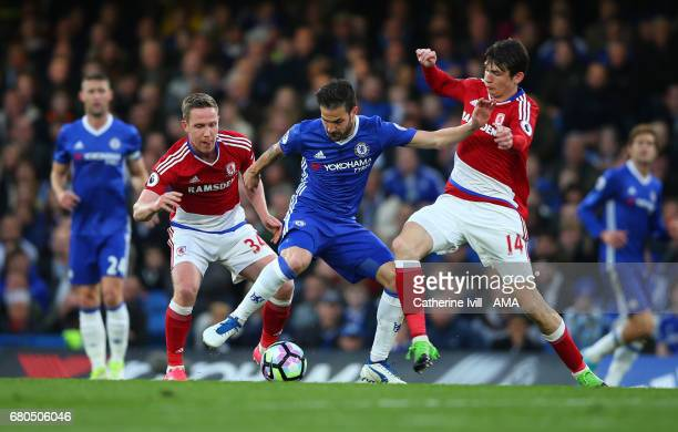 Cesc Fabregas of Chelsea is tackled by Adam Forshaw and Marten de Roon of Middlesbrough during the Premier League match between Chelsea and...