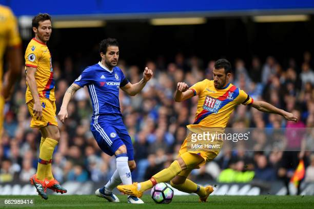 Cesc Fabregas of Chelsea is tackled by Luka Milivojevic of Crystal Palace during the Premier League match between Chelsea and Crystal Palace at...
