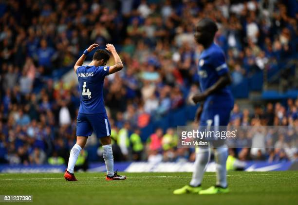 Cesc Fabregas of Chelsea leaves the field dejected after being shown a red card by Referee Craig Pawson during the Premier League match between...