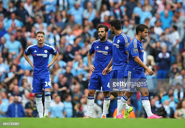 Cesc Fabregas of Chelsea looks dejected with team mates after the third Manchester City goal scored by Fernandinho of Manchester City during the...