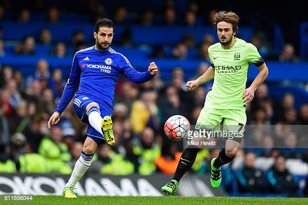 Cesc Fabregas of Chelsea passes as Aleix Garcia Serrano of Manchester City closes in during The Emirates FA Cup fifth round match between Chelsea and...