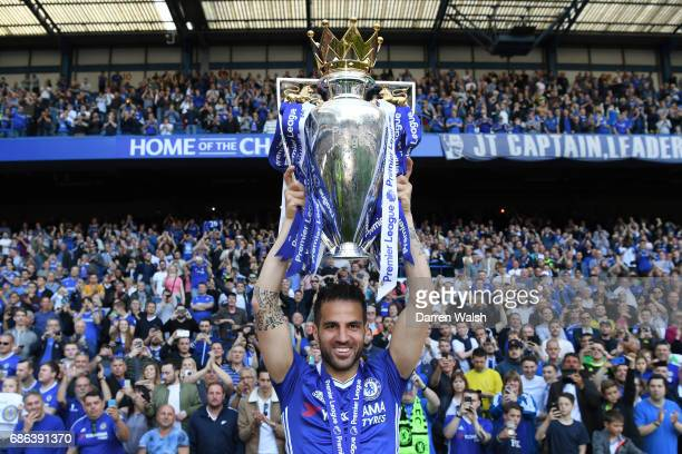 Cesc Fabregas of Chelsea poses with the Premier League Trophy after the Premier League match between Chelsea and Sunderland at Stamford Bridge on May...
