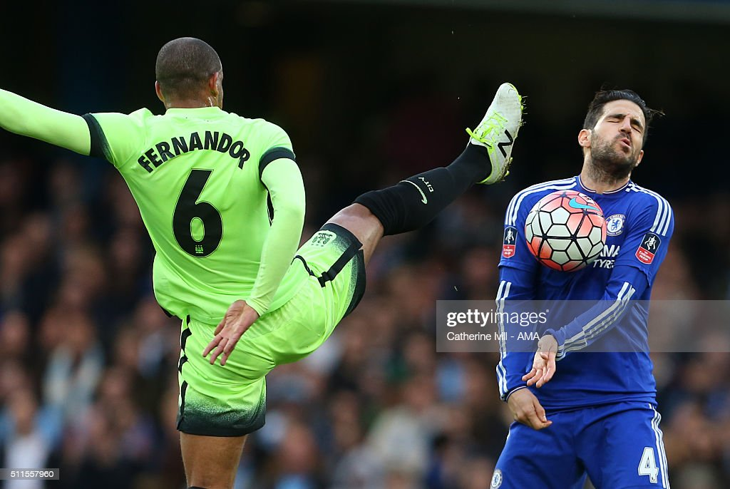 Cesc Fabregas of Chelsea reacts as Fernando of Manchester City kicks high during the Emirates FA Cup match between Chelsea and Manchester City at Stamford Bridge on February 21, 2016 in London, England.