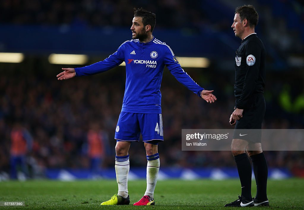Cesc Fabregas of Chelsea remonstrates with referee Mark Clattenburg during the Barclays Premier League match between Chelsea and Tottenham Hotspur at Stamford Bridge on May 02, 2016 in London, England.