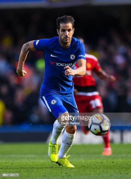 Cesc Fabregas of Chelsea runs with the ball during the Premier League match between Chelsea and Watford at Stamford Bridge on October 21 2017 in...