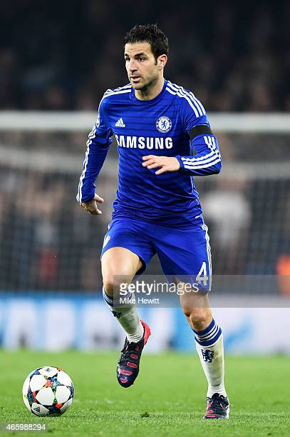 Cesc Fabregas of Chelsea runs with the ball during the UEFA Champions League Round of 16 second leg match between Chelsea and Paris SaintGermain at...