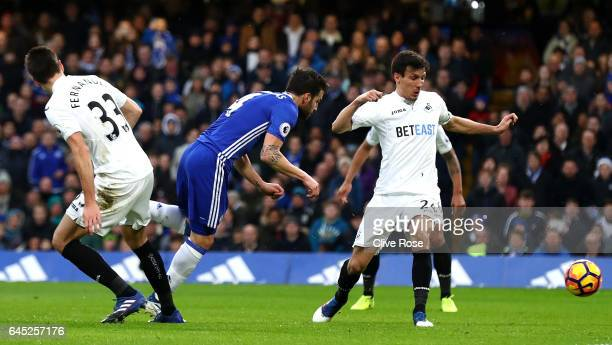 Cesc Fabregas of Chelsea scores his sides first goal during the Premier League match between Chelsea and Swansea City at Stamford Bridge on February...