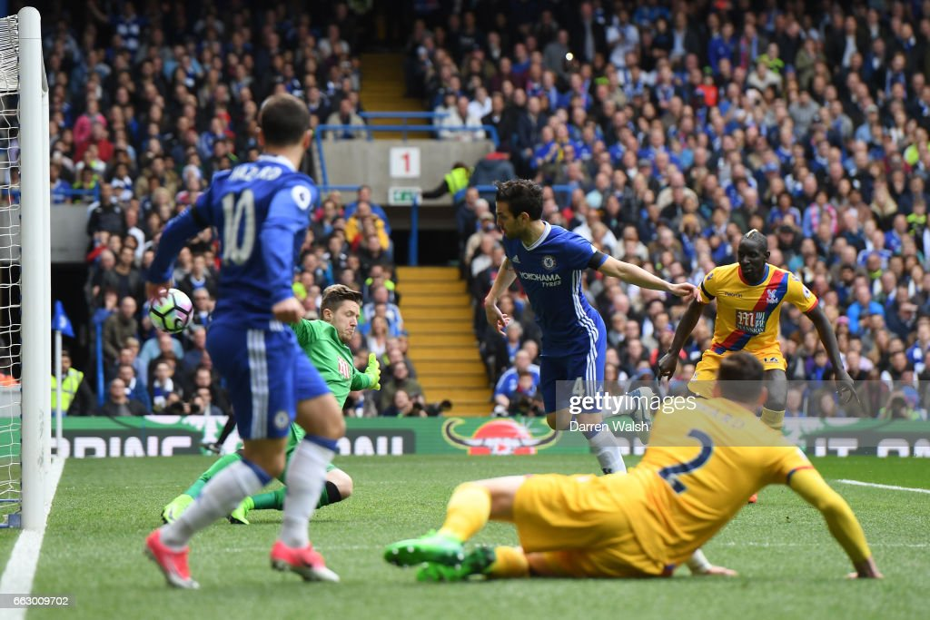 Cesc Fabregas of Chelsea scores his sides first goal during the Premier League match between Chelsea and Crystal Palace at Stamford Bridge on April 1, 2017 in London, England.