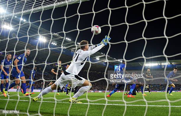Cesc Fabregas of Chelsea scores his sides fourth goal past RonRobert Zieler of Leicester City during the EFL Cup Third Round match between Leicester...