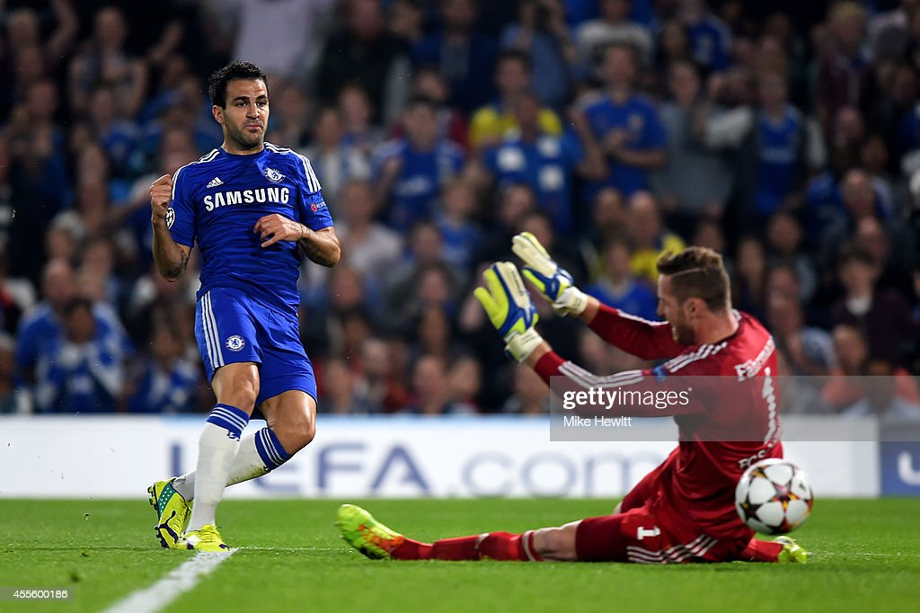 Cesc Fabregas of Chelsea scores the opening goal past <a gi-track='captionPersonalityLinkClicked' href=/galleries/search?phrase=Ralf+Faehrmann&family=editorial&specificpeople=808591 ng-click='$event.stopPropagation()'>Ralf Faehrmann</a> of Schalke during the UEFA Champions League Group G match between Chelsea and FC Schalke 04 on September 17, 2014 in London, United Kingdom.