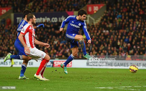 Cesc Fabregas of Chelsea scores their second goal during the Barclays Premier League match between Stoke City and Chelsea at Britannia Stadium on...