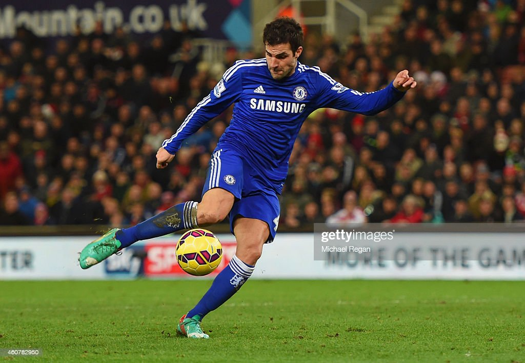 Cesc Fabregas of Chelsea scores their second goal during the Barclays Premier League match between Stoke City and Chelsea at Britannia Stadium on December 22, 2014 in Stoke on Trent, England.