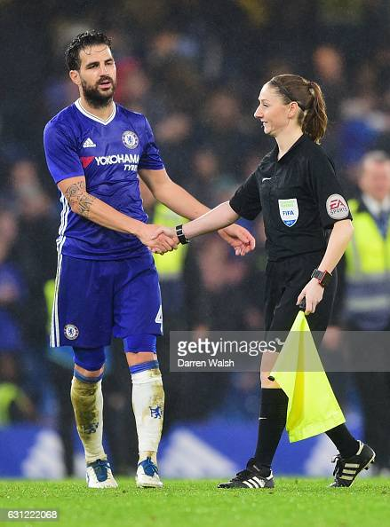 Cesc Fabregas of Chelsea shakes hands with assistant referee Sian MasseyEllis after the game during The Emirates FA Cup Third Round match between...