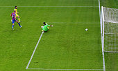 Cesc Fabregas of Chelsea shoots past Julian Speroni of Crystal Palace as he scores their second goal during the Barclays Premier League match between...