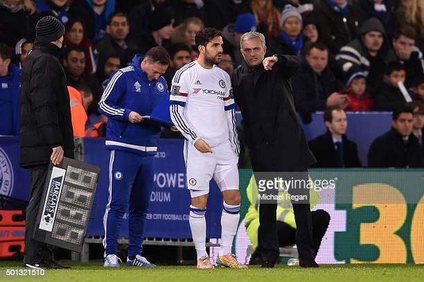 Cesc Fabregas of Chelsea speaks with Jose Mourinho the manager of Chelsea as he prepares to come on as a substitue during the Barclays Premier League...