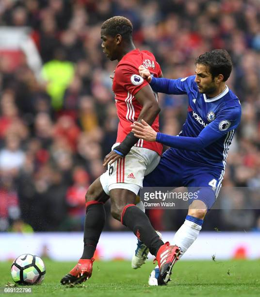 Cesc Fabregas of Chelsea tackles Paul Pogba of Manchester United during the Premier League match between Manchester United and Chelsea at Old...