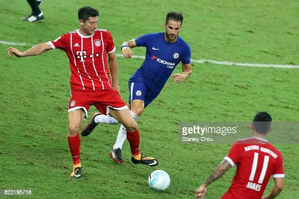 Cesc Fabregas of Chelsea tackles Robert Lewandowski of Bayern Munich during the International Champions Cup match between Chelsea FC and FC Bayern...