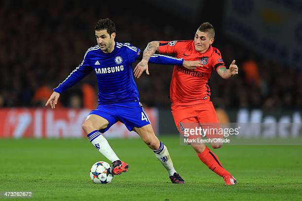Cesc Fabregas of Chelsea tangles with Marco Verratti of Paris St Germain during the UEFA Champions League Round of 16 second leg match between...