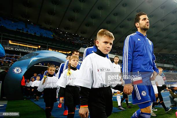 Cesc Fabregas of Chelsea walks out with the mascots prior to the UEFA Champions League Group G match between FC Dynamo Kyiv and Chelsea at the...