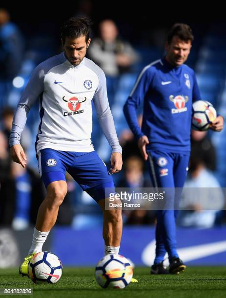 Cesc Fabregas of Chelsea warms up during the Premier League match between Chelsea and Watford at Stamford Bridge on October 21 2017 in London England