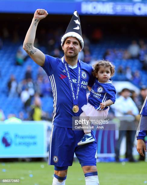 Cesc Fabregas of Chelsea wears a magicians hat as he carries his daughter after the Premier League match between Chelsea and Sunderland at Stamford...