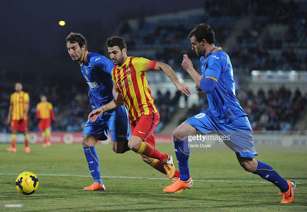 Cesc Fabregas (C) of FC Barcelona battles for the ball against Pedro Mosquera of Getafe CF during the La Liga match between Getafe CF and FC Barcelona at Coliseum Alfonso Perez on December 22, 2013 in Getafe, Spain.