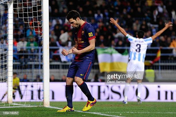 Cesc Fabregas of FC Barcelona celebrates after scoring his team's second goal during the La Liga match between Malaga CF and FC Barcelona at La...