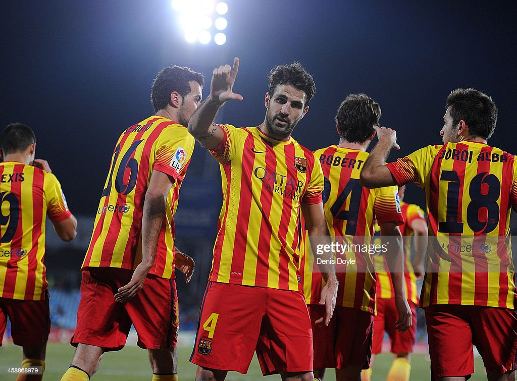 Cesc Fabregas of FC Barcelona celebrates after scoring their fifth goal during the La Liga match between Getafe CF and FC Barcelona at Coliseum Alfonso Perez on December 22, 2013 in Getafe, Spain.