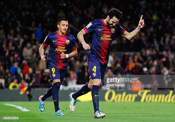Cesc Fabregas of FC Barcelona celebrates with his teammate Alexis Sanchez of FC Barcelona after scoring his team's fifth goal during the La Liga...