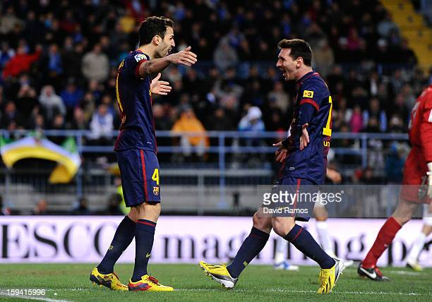 Cesc Fabregas of FC Barcelona celebrates with his teammate Lionel Messi of FC Barcelona after scoring his team's second goalduring the La Liga match...
