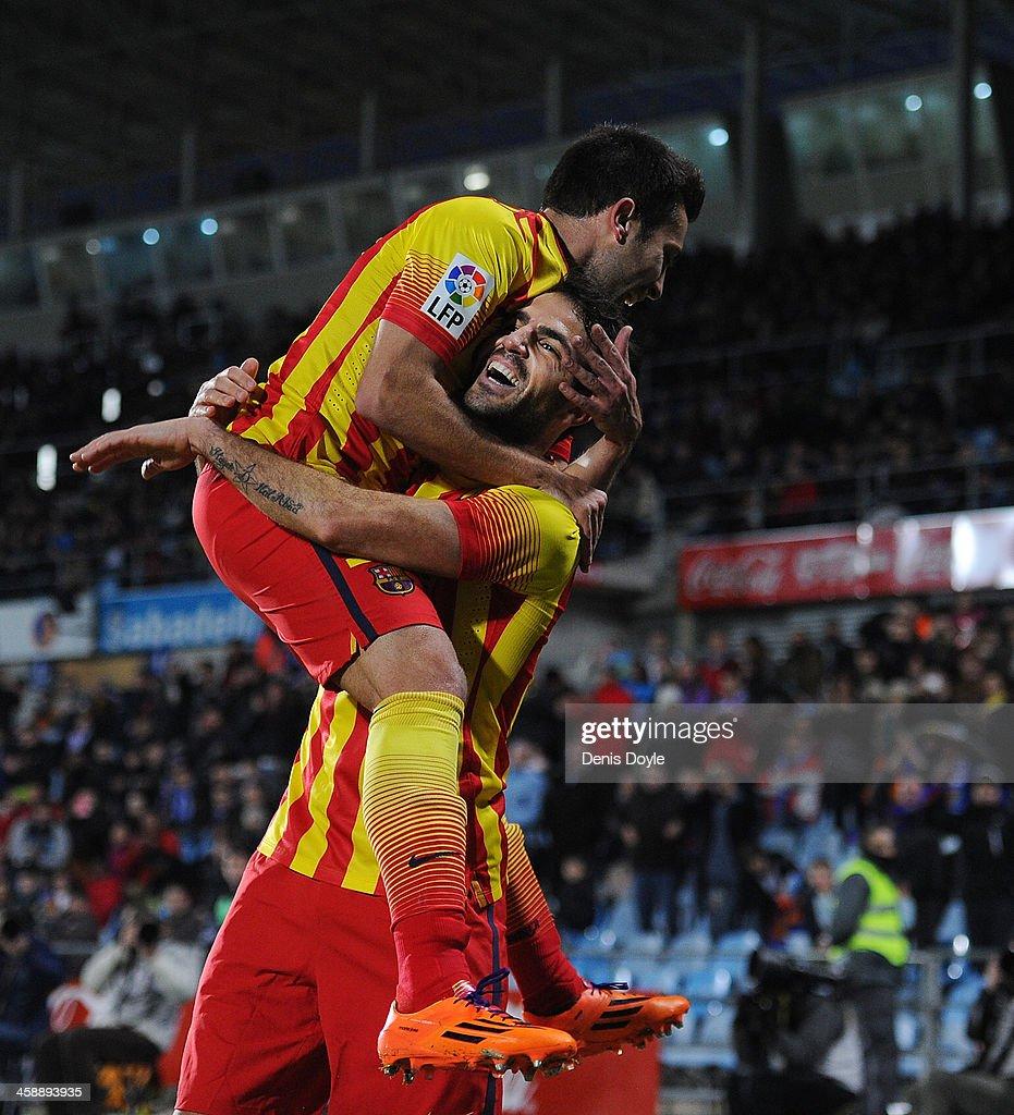 Cesc Fabregas of FC Barcelona celebrates with Jordi Alba after scoring Barcelona's 4th goal during the La Liga match between Getafe CF and FC...