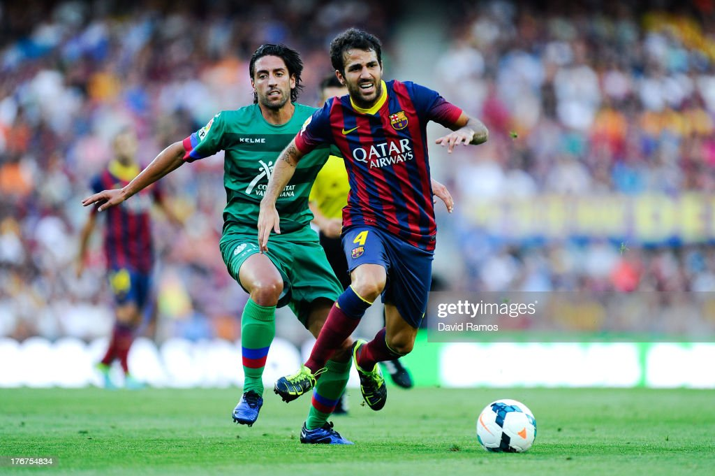 Cesc Fabregas of FC Barcelona competes for the ball Miguel Pallardo Gonzalez of Levante UD during the La Liga match between FC Barcelona and Levante UD at Camp Nou on August 18, 2013 in Barcelona, Spain.