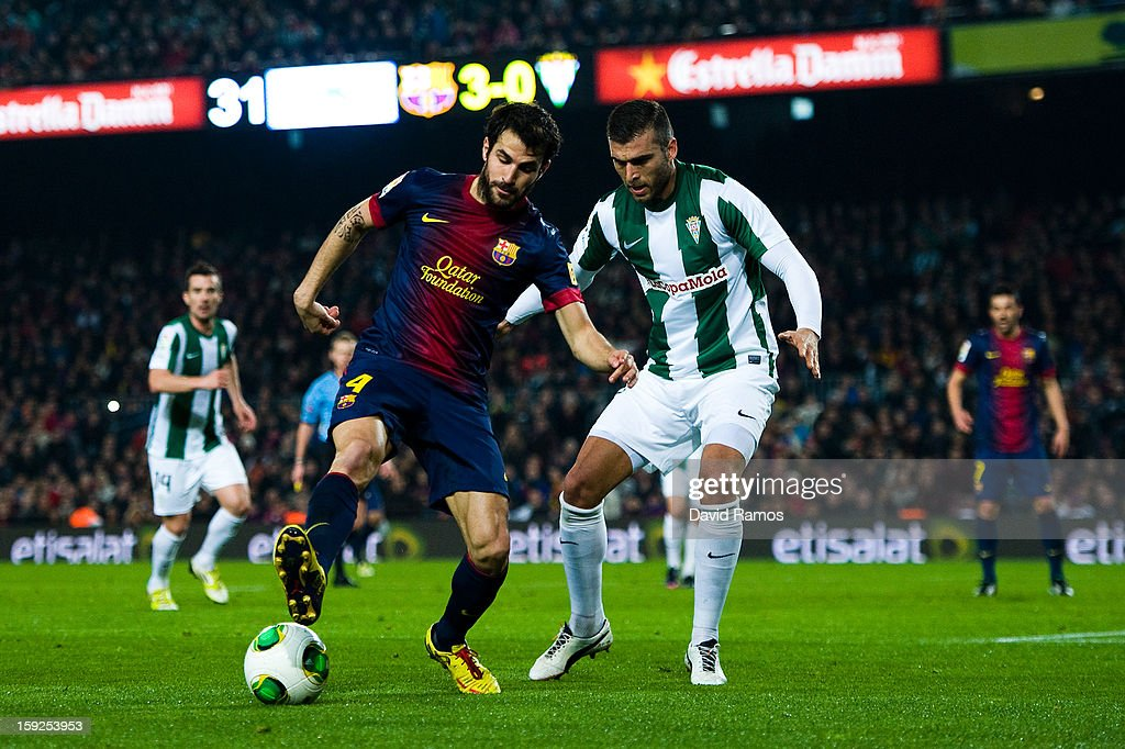 Cesc Fabregas of FC Barcelona (L) duels for the ball with Armando Lozano of Cordoba CF during the Copa del Rey round of sixteen second leg match between FC Barcelona and Cordoba CF at Camp Nou on January 10, 2013 in Barcelona, Spain.