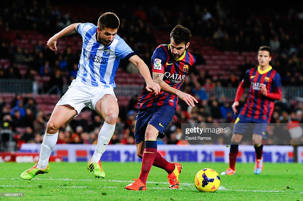Cesc Fabregas of FC Barcelona duels for the ball with Ignacio Camacho of Malaga CF during the La Liga match between FC Barcelona and Malaga CF at Camp Nou on January 26, 2014 in Barcelona, Spain.