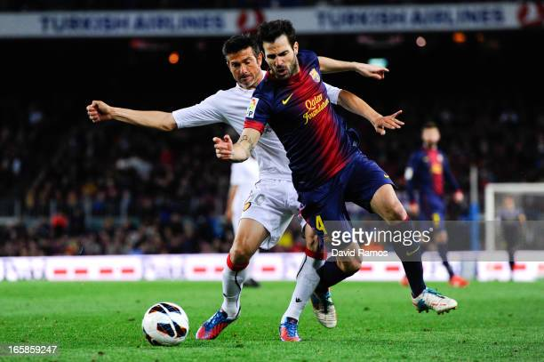 Cesc Fabregas of FC Barcelona duels for the ball with Jose Luis Marti of RCD Mallorca during the La Liga match between FC Barcelona and RCD Mallorca...