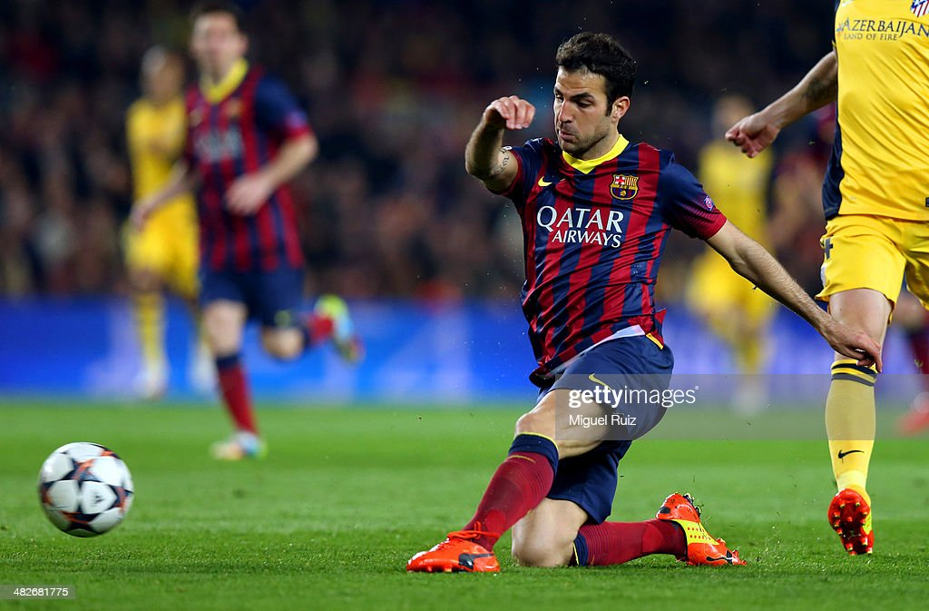 Cesc Fabregas (C) of FC Barcelona kicks the ball during the UEFA Champions League Quarter Final first leg between FC Barcelona and Club Atletico de Madrid at Nou Camp on April 1, 2014 in Barcelona, Spain.